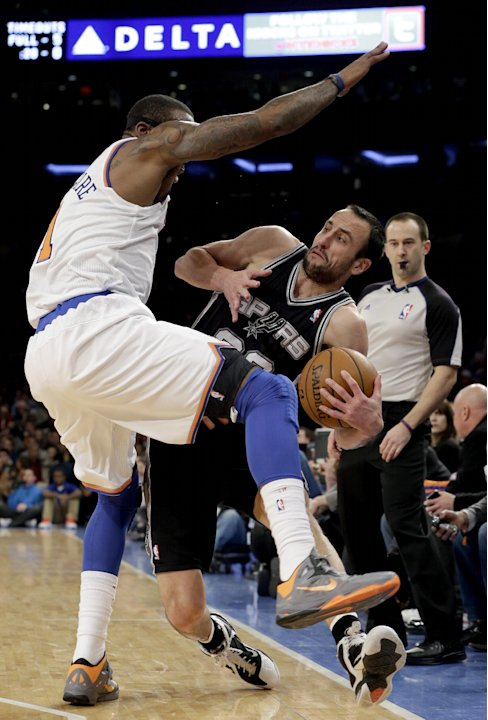 San Antonio Spurs guard Manu Ginobili (20) tries to stay in bounds as he passes around New York Knicks forward Amare Stoudemire (1) in the first half of their NBA basketball game at Madison Square Gar