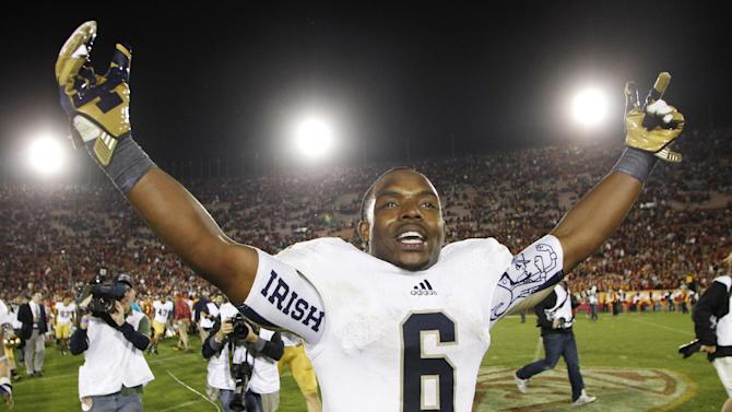 Notre Dame running back Theo Riddick celebrates after Notre Dame defeated Southern California 22-13 in an NCAA college football game, Saturday, Nov. 24, 2012, in Los Angeles. (AP Photo/Danny Moloshok)