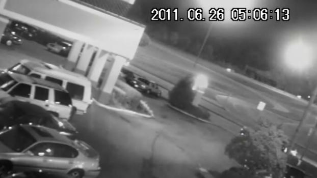 In this June 26, 2011 frame grab from a security video, a pickup truck can barely be seen hitting James Craig Anderson, a 49-year-old black man on a Jackson, Miss., street in the top right corner of the frame. The truck's driver, Deryl Dedmon, a white teen, is accused of having driven out of the parking lot and having run down James Craig Anderson, a 49-year-old black man, on the Jackson street. The incident, stoked in part by security camera footage showing Anderson being run over, is causing people across the country to sound off on social media pages created for and against the defendants. (AP Photo)