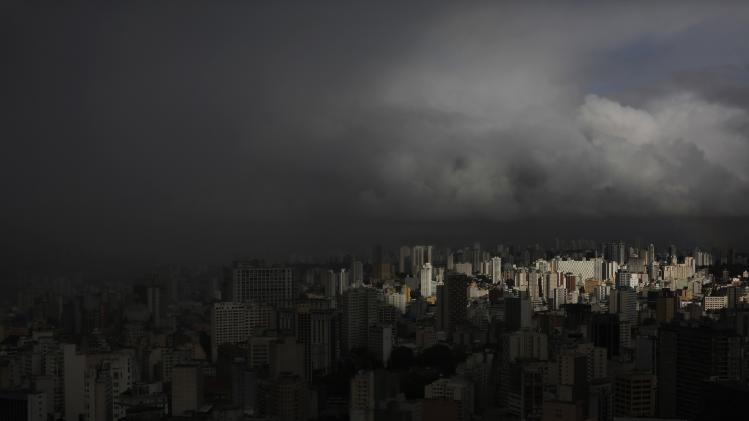 Rain clouds gather over the city of Sao Paulo