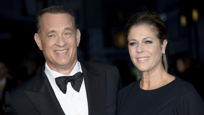 """FILE - In this Oct. 9, 2013 file photo, U.S actors Tom Hanks and Rita Wilson arrive for the BFI London Film Festival European Premiere of """"Captain Phillips,"""" at a central London cinema. A Southern California insurance broker who overcharged Hanks and his wife, Wilson, hundreds of thousands of dollars has been sentenced to more than two years in federal prison. City News Service says Jerry Goldman received a 27-month sentence Monday, Nov. 4, 2013. (Photo by Jonathan Short/Invision/AP, File)"""