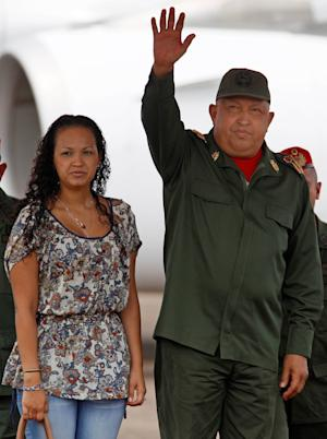 Venezuela's President Hugo Chavez, right, accompanied by his daughter Rosa, waves upon his arrival to La Fria, Venezuela, Thursday, Oct. 20, 2011. Chavez said he is cancer-free because a series of medical exams in Cuba showed no recurrence of the illness following two months of chemotherapy treatments.  Chavez underwent surgery in Cuba in June to remove a cancerous tumor from his pelvic region. He has not revealed where the tumor was located nor the type of cancer with which he was diagnosed. (AP Photo/Fernando  Llano)