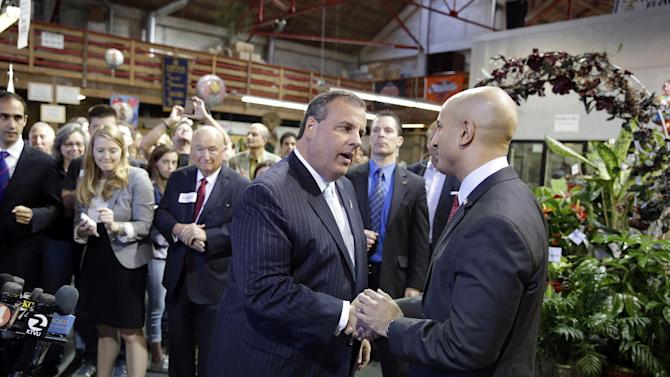 FILE - In this file photo from Friday, June 13, 2014, New Jersey Gov. Chris Christie, left, shakes hands with California gubernatorial candidate Neel Kashkari, right, at the end of a visit to Hoogasian Flowers in San Francisco. California Republicans achieved their modest goals of last year by preventing Democrats from achieving a two-thirds majority in both houses of the state Legislature and rescuing the party's finances. The longer term challenges for for Republicans in California are more stark. Party delegates meet this weekend in Sacramento. (AP Photo/Eric Risberg)
