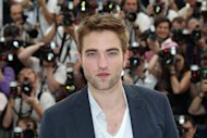 "British actor Robert Pattinson poses during the photocall of ""Cosmopolis"" at the 65th Cannes Film Festival on May 25. Pattinson said Friday he was terrified making his Cannes debut as a sex-mad billionaire, in part because director David Cronenberg told him it would entail a nude on-screen medical exam"