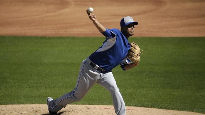 Kansas City Royals pitcher Yohan Pino throws during the third inning of a spring training baseball game against the Texas Rangers Wednesday, March 4, 2015, in Surprise, Ariz. (AP Photo/Charlie Riedel)