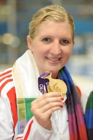England's Rebecca Adlington with her gold medal after winning the Women's 800m Freestyle during Day Four of the 2010 Commonwealth Games at the Dr SPM