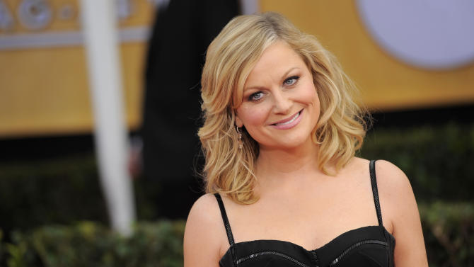 Amy Poehler arrives at the 19th Annual Screen Actors Guild Awards at the Shrine Auditorium in Los Angeles on Sunday Jan. 27, 2013. (Photo by Chris Pizzello/Invision/AP)