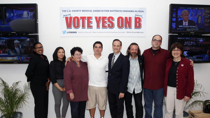 IMAGE DISTRIBUTED FOR AIDS HEALTHCARE FOUNDATION - From left. Samantha Granberry, Arlette DeLaCruz, Miki Jackson, Derick Burts, Michael Weinstein, Mark McGrath, Whitney Engeran-Cordova, and Dr. Paula Tavrow are seen at the AIDS Healthcare Foundation Election Headquarters victory party on Tuesday, November 6, 2012 in Los Angeles, California. Early results show strong support for Measure B. (Joe Kohen/AP Images for AIDS Healthcare Foundation)