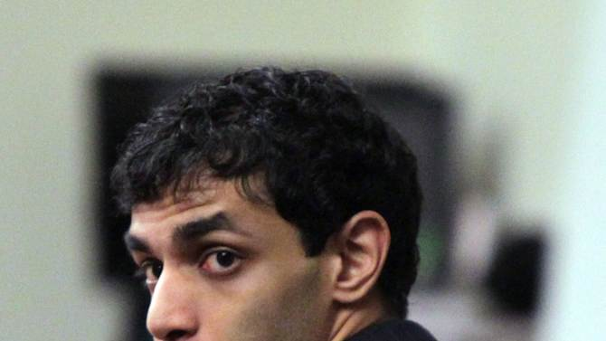 FILE - In this March 14, 2012 file photo, Dharun Ravi waits for the judge to explain the law to the jury before they begin their deliberations during his trial at the Middlesex County Courthouse in New Brunswick, N.J. Ravi was convicted Friday, March 16, 2012, of anti-gay intimidation for using a webcam to spy on his gay roommate's love life. The roommate, 18-year-old Tyler Clementi, threw himself to his death off a bridge not long after realizing he'd been watched. Although there was a verdict in the case, there is no resolution to a broader question that hovered over it: To what extent are hate crime laws a help or a hindrance in the pursuit of justice? (AP Photo/The Star-Ledger, John O'Boyle, Pool, File)