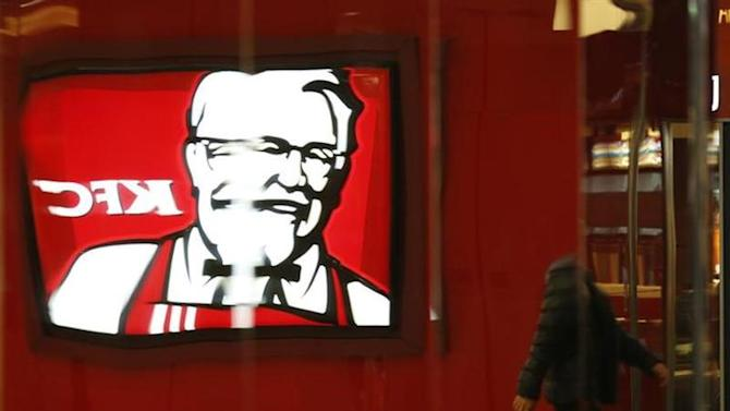 The logo of KFC restaurant is reflected on a metal wall at a shopping mall in Beijing