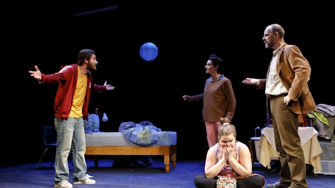 "This publicity photo released by Boneau/Bryan-Brown shows, from left,  Jake Gyllenhaal, Michelle Gomez, Annie Funke, seated, and Brian F. O'Byrne in a scene from Nick Payne's ""If There Is I Haven't Found It Yet,"" performing off-Broadway at Roundabout at Laura Pels Theatre in New York. (AP Photo/Boneau/Bryan-Brown, Joan Marcus)"