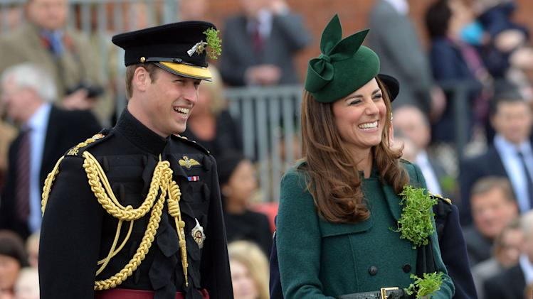 Britain's Prince William and Catherine, Duchess of Cambridge wear sprigs of shamrock during a visit to the 1st Battalion Irish Guards for a St Patrick's Day Parade at Mons Barracks in Aldershot