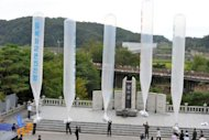 Anti-Pyongyang activists, including North Korean defectors, float giant balloons carrying leaflets criticising North Korean leader Kim Jong-Un from Imjingak park near the North-South border in Paju in September 2012. The North Korean army threatened Friday to carry out a &quot;merciless military strike&quot; against South Korea next week, in a serious escalation of cross-border tensions