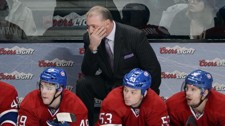 Montreal Canadiens head coach Michel Therrien keeps an eye on the action as Montreal Canadiens left wing Michael Bournival, left, Ryan White (53) and Travis Moen, right, look on during third period NHL action against the Florida Panthers Sunday, Dec. 15, 2013 in Montreal. Florida won the game 2-1