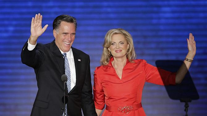 Ann Romney is greeted on stage by her husband Republican presidential nominee Mitt Romney after her speech to the Republican National Convention in Tampa, Fla. on Tuesday, Aug. 28, 2012.  (AP Photo/J. Scott Applwhite)
