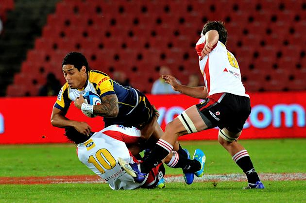 Reds player Luke Morahan  is tackled by Lions  Flyhalf Elton Jantjies during the Super 15 Rugby Match between Lions and  Brumbies at Ellis Park, Stadium in Johannesburg on April 27, 2012. AFP PHOTO /