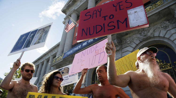 FILE  - In this Nov. 14, 2012 file photo, demonstrators gather at a protest against a proposed nudity ban outside of City Hall in San Francisco. San Francisco lawmakers are getting ready to bare their decision on a proposed ban on public nakedness that has sparked indignation in a city known for flouting convention and flaunting its counter-culture image. The 11-member Board of Supervisors is scheduled to vote Tuesday, Nov. 20, 2012 on the ordinance, which would prohibit exposed genitals in most public places, including streets, sidewalks and public transit. (AP Photo/Marcio Jose Sanchez, File)