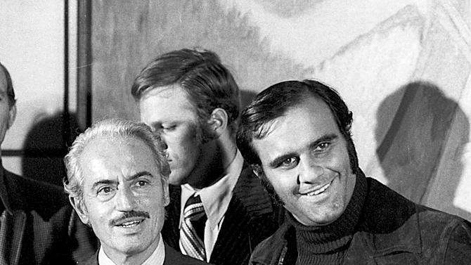 FILE - This April 13, 1972 file photo shows Marvin Miller, left, executive director of the Major League Baseball Players Association, and Joe Torre, of the St. Louis Cardinals, talking to news reporters after Miller announced an end to the baseball strike, in New York. Miller, the union leader who created free agency for baseball players and revolutionized professional sports with multimillion dollar contracts, died Tuesday, Nov. 27, 2012 in New York. He was 95.(AP Photo/File)