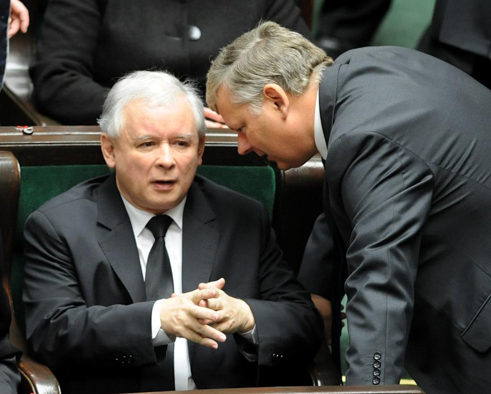 Opposition leader Jaroslaw Kaczynski, left, speaks with his lawmaker Marek Suski during the first session of the new Polish Parliament, in Warsaw, Poland, Tuesday, Nov. 8, 2011. (AP Photo/Alik Keplicz)