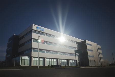 File of the sun reflected on a building inside the Blackberry maker's Research in Motion RIM Technology Park in Waterloo