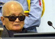 "This photo, released by the Extraordinary Chamber in the Courts of Cambodia (ECCC) on January 10, shows former Khmer Rouge leader ""Brother Number Two"" Nuon Chea sitting in the courtroom in Phnom Penh"