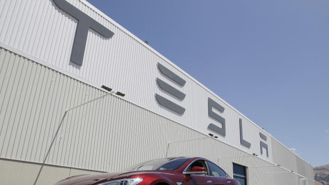 A Tesla Model S drives outside the Tesla factory in Fremont, Calif., Friday, June 22, 2012. The first Model S sedan car will be rolling off the assembly line on Friday.  (AP Photo/Paul Sakuma)