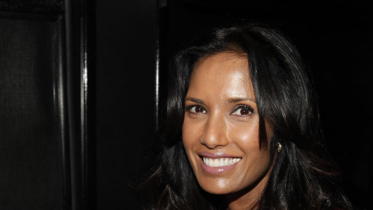 """IMAGE DISTRIBUTED FOR V8 - Padma Lakshmi gets an energy boost while multi-tasking during her visit to the V8 V-Fusion + Energy 24th Hour Mega Bus on Friday, March 8, 2013 in New York City. Naturally powered by ingredients like green tea, vegetables and fruit, V8 V-Fusion + Energy is helping Americans """"Spring Forward"""" this weekend when they've lost an hour of sleep. (Amy Sussman / AP Images for V8)"""