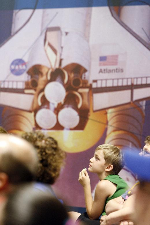 Mason Phillips, 9, eats popcorn while attending the Mars Curiosity Landing Party early Monday morning, Aug. 6, 2012, at the Kansas Cosmosphere and Space Center in Hutchinson, Kan. (AP Photo/The Hutchinson News, Lindsey Bauman)