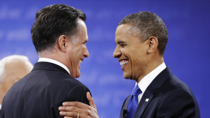 Republican presidential nominee Mitt Romney, left is greeted by President Barack Obama before the start of the third presidential debate at Lynn University, Monday, Oct. 22, 2012, in Boca Raton, Fla. (AP Photo/David Goldman)