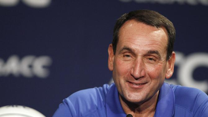 Duke coach Mike Krzyzewski smiles during the Atlantic Coast Conference NCAA college basketball media day in Charlotte, N.C., Wednesday, Oct. 16, 2013