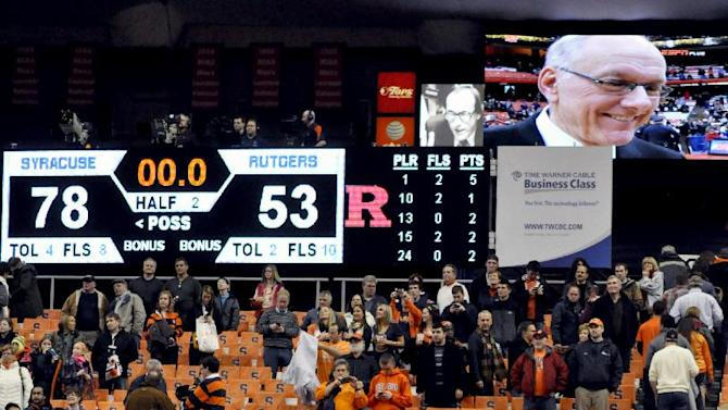 Syracuse head coach Jim Boeheim, top right, is broadcast on a digital screen during an interview after his team defeated Rutgers 78-53 for his 903rd career victory passing Bobby Knight in an NCAA college basketball game in Syracuse, N.Y., Wednesday, Jan. 2, 2013. (AP Photo/Kevin Rivoli)