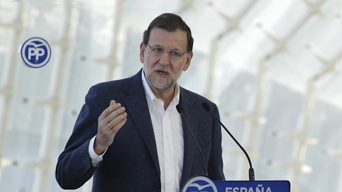Spain's PM Rajoy delivers a speech during meeting with People Party's candidates for parliament and supporters ahead upcoming general elections next month in Valencia