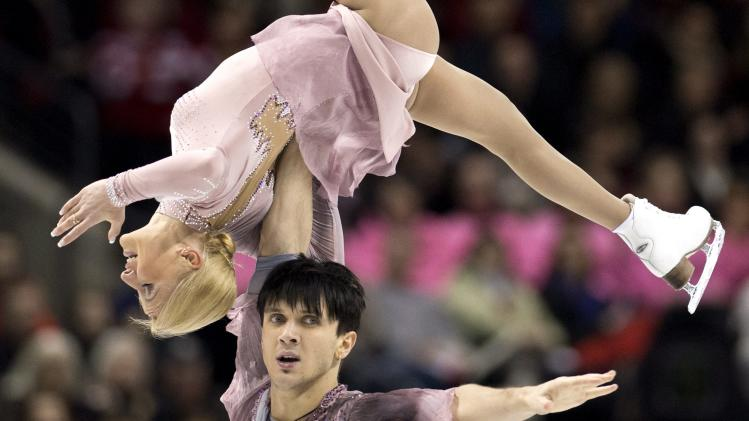 Tatiana Volosozhar is lifted by her partner Maxim Trankov from Russia, during their free skate program in the pairs competition at the World Figure Skating Championships Friday, March 15, 2013 in London, Ontario. (AP Photo/The Canadian Press, Paul Chiasson)
