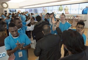 Employees greet the first shoppers at the opening of the first international Microsoft Store in Toronto on November 16, 2012. THE CANADIAN PRESS/Frank Gunn