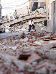 A man looks among the rubble in Lorca, Spain, on Thursday, May 12, 2011. Two earthquakes shook southeastern Spain in quick succession Wednesday, killing people, injuring dozens and causing extensive damage to buildings. It was the largest number of earthquake-related deaths in Spain over 50 years.