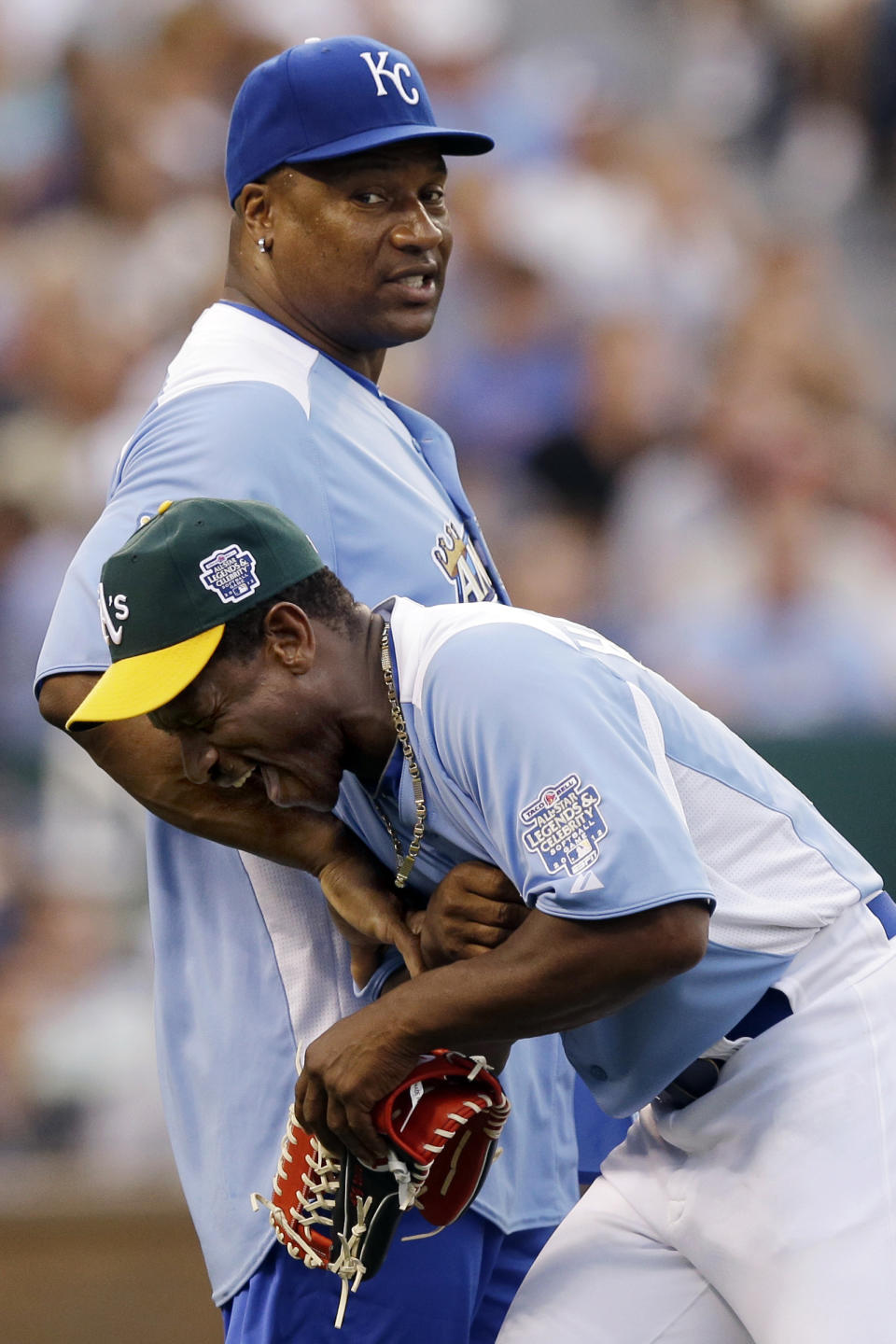 Hall of Famer Ricky Henderson, bottom, laughs with former baseball and football star Bo Jackson during the first inning of the MLB All-Star celebrity softball game, Sunday, July 8, 2012, in Kansas City, Mo. (AP Photo/Charlie Riedel)