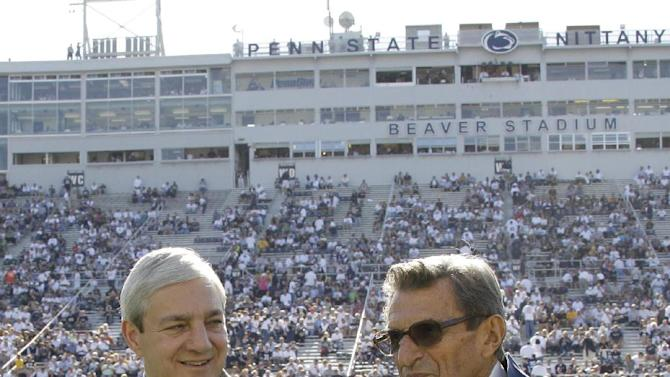 "FILE - In this  Oct. 8, 2011, file photo Penn State president Graham Spanier, left, and head football coach Joe Paterno talk before an NCAA college football game against Iowa in State College, Pa. Spanier is accused of perjury, endangering children and other charges in the Jerry Sandusky molestation scandal. According to online court records charges were filed, Thursday, Nov. 1, 2012, against Penn State's ex-president and two other administrators in what prosecutors called ""a conspiracy of silence."" (AP Photo/Gene Puskar, File)"