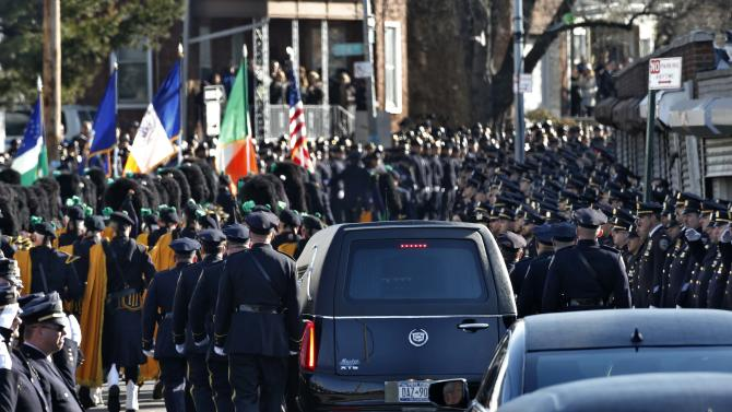 A hearse carrying the casket containing the body of slain New York Police Department (NYPD) officer Rafael Ramos departs the Christ Tabernacle Church to it's final resting place in the Queens borough of New York