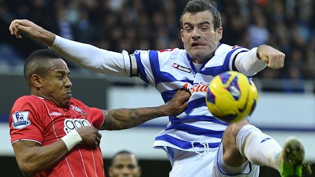 Queens Park Rangers' Ryan Nelsen (R) challenges for the ball with Southampton's Nathaniel Clyne (Reuters)