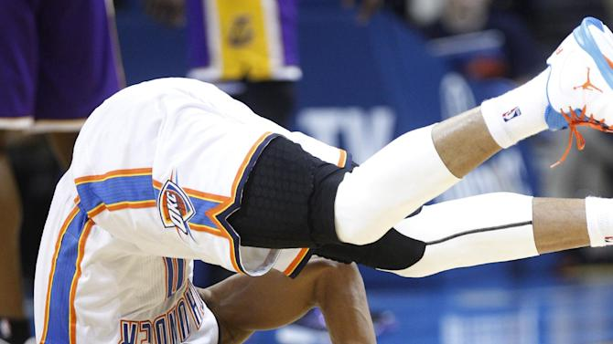 Oklahoma City Thunder guard Russell Westbrook turns a somersault on the floor after scoring against the Los Angeles Lakers in the second quarter of an NBA basketball game in Oklahoma City, Friday, Dec. 7, 2012. (AP Photo/Sue Ogrocki)