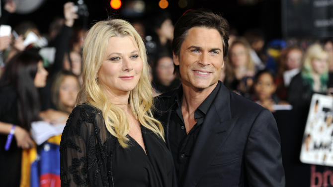 "Rob Lowe, right, and wife Sheryl Berkoff arrive at the world premiere of ""The Twilight Saga: Breaking Dawn - Part 1"" on Monday, Nov. 14, 2011, in Los Angeles. (AP Photo/Chris Pizzello)"