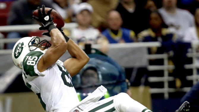 New York Jets wide receiver Chaz Schilens catches a 25-yard pass for a touchdown during the second quarter of an NFL football game against the St. Louis Rams, Sunday, Nov. 18, 2012, in St. Louis. (AP Photo/Tom Gannam)
