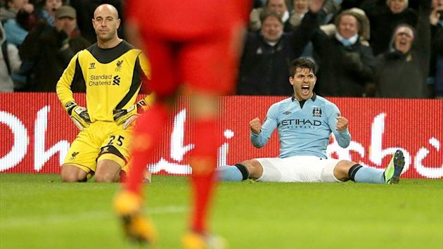 Sergio Aguero celebrates his equaliser against liverpool, whose goalkeeper Pepe Reina looks dejected (PA Photos)