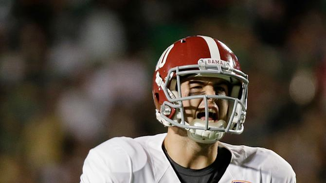 Alabama's AJ McCarron celebrates during the first half of the BCS National Championship college football game against Notre Dame Monday, Jan. 7, 2013, in Miami. (AP Photo/David J. Phillip)