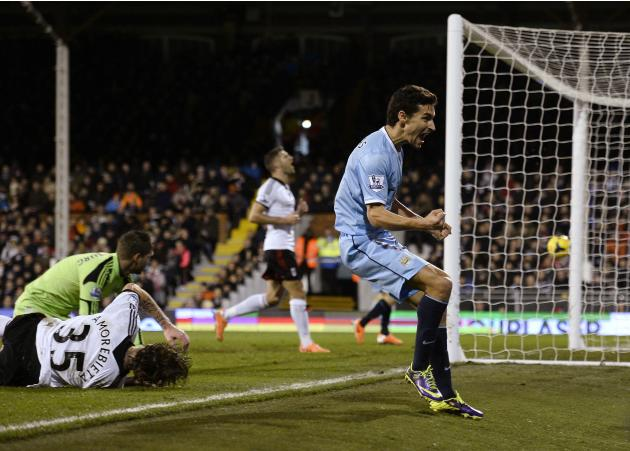 Manchester City's Navas celebrates his goal against Fulham during their English Premier League soccer match in London