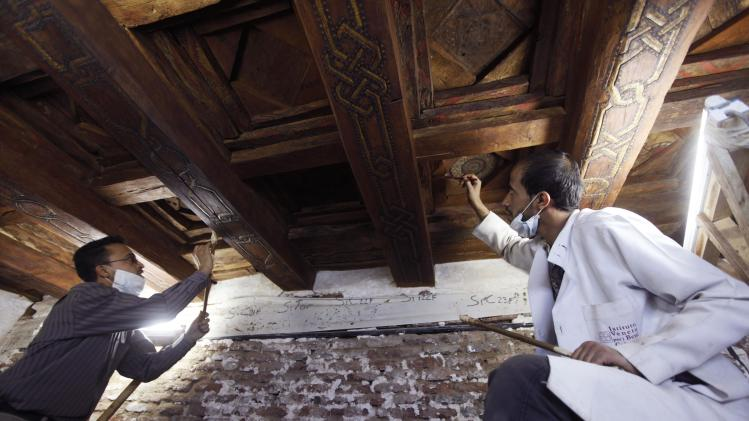 Restorers work on the ceiling of the Grand Mosque in the old city of Sana'a
