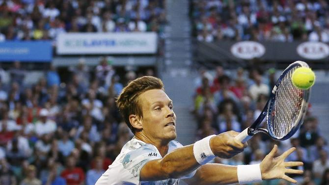 Berdych of Czech Republic hits a return to Murray of Britain during men's singles semi-final match at the Australian Open 2015 tennis tournament in Melbourne