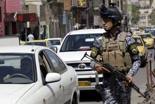 <p>An Iraqi police officer guards a checkpoint in central Baghdad on August 4, 2012. A car bomb at an Iraqi Kurdish political party headquarters in the town of Jalawla killed two Kurdish security recruits and wounded two on Sunday, security and medical officials said.</p>