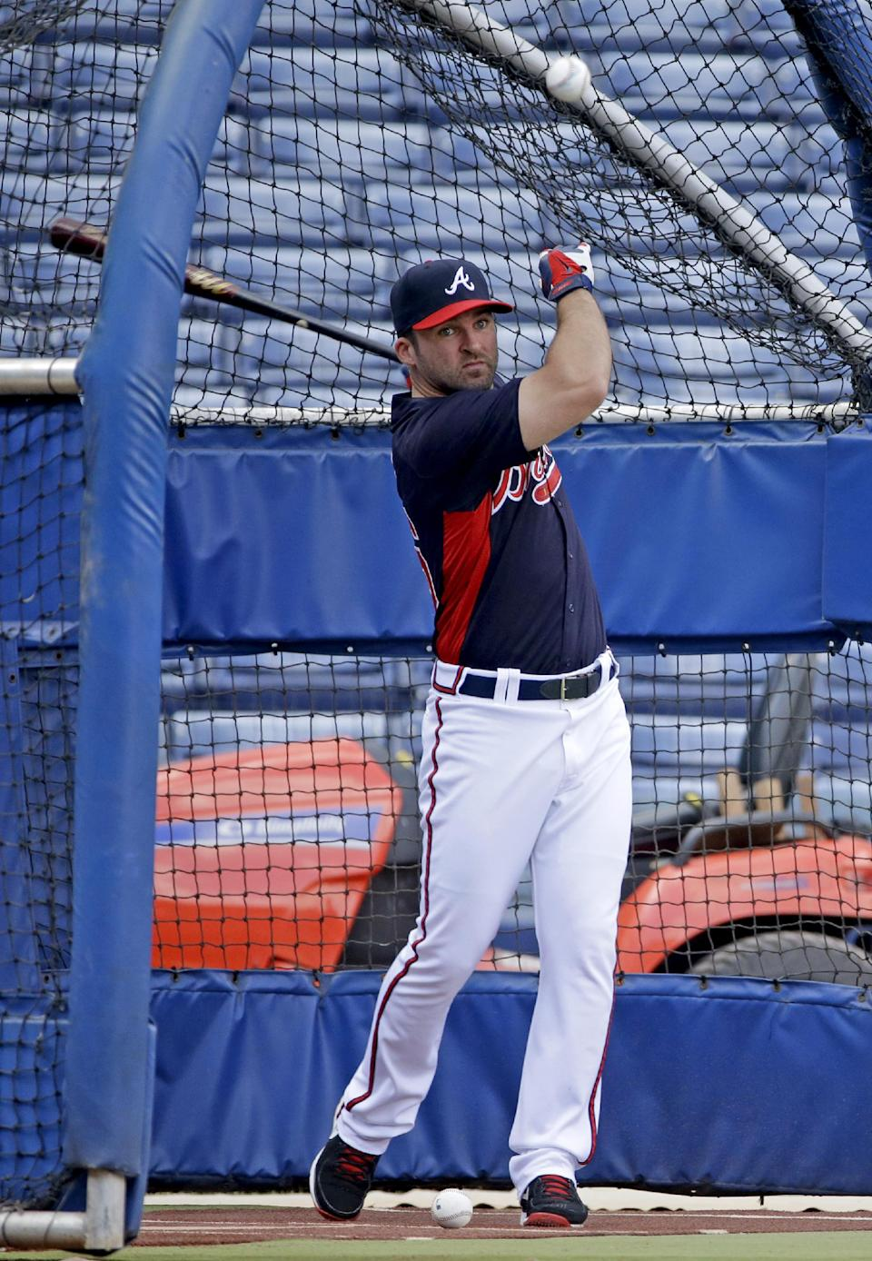 Uggla 'upset' to be left off Braves roster