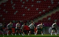 Poland's national football team take part in a training session at the National Stadium in Warsaw. Poland were on Thursday preparing to kick off Euro 2012 on home soil, with opponents Greece seeking a morale-boosting win to lift a beleaguered nation hit by political turmoil and crippling financial woes